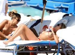 http://img268.imagevenue.com/loc135/th_260220333_lauren_stoner_bikini_topless_march19_2012_41_123_135lo.jpg